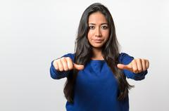 Woman giving an equal thumbs gesture Stock Photos