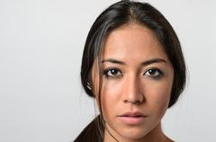 Woman with serious blank stare - stock photo