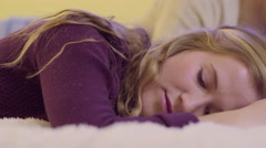 Closeup Of Teen, She Seems Sad Or Lost In Thought, Her Friend Lays Beside Her Stock Footage