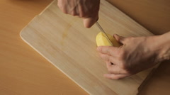 Man cut potatoes in the kitchen Stock Footage