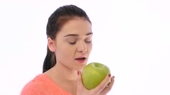 Girl Bites an Apple and Feels Bad Stock Footage