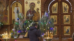 Man is Crossing Cameraman Dormition Cathedral Christmas Worshiper in Front of - stock footage