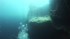 Rising air bubbles under water. - stock footage