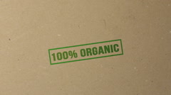 100% organic green ink stamp on documents folder Stock Footage