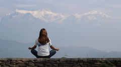 Girl meditating on the background of Annapurna - stock footage