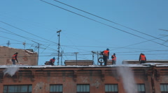 Workers clean the roof from snow Stock Footage