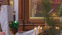 Man Lights a Candle Christmas at Holy Mountain Lavra Dormition Cathedral - stock footage