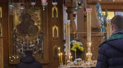 Man Praying at Image Dormition Cathedral Christmas Worshiper in Front of Icon - stock footage