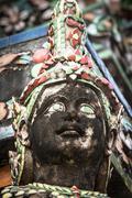 Demon Guardian statues decorating the Buddhist temple Wat Arun in Bangkok, Th Stock Photos