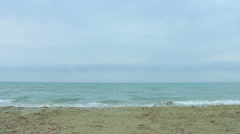 Stock Video Footage of Choppy sea water, waves splashing, wind blowing on the beach. Stormy weather