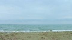 Choppy sea water, waves splashing, wind blowing on the beach. Stormy weather - stock footage