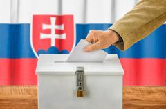 Man putting a ballot into a voting box - Slovakia - stock photo