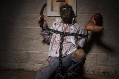 halloween monster chained with bloody hook, night scene and terror - stock photo