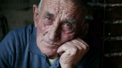 Sad old man alone with his thoughts at home - stock footage
