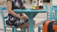 Beautiful lady sitting in street cafe, chatting online, texting on smartphone Stock Footage