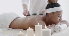 Woman Getting Hot Stone Massage Stock Footage