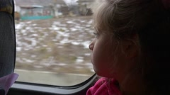 Girl is Observing a Village Houses Bare Branches Trees Little Blonde Girl is - stock footage