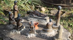 Figurine of the sleeping Buddha and his disciples Stock Footage