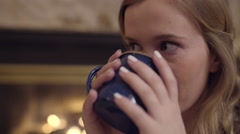 Closeup Of Teen As She Sips Hot Chocolate And Laughs At A Friend Off-Screen Stock Footage