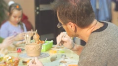 Man is Painting a Clay Pot With Cat Figurine Glazing Pot by Brush Painting Stock Footage