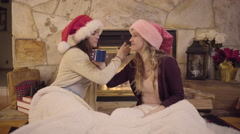 Cute Teens Wearing Santa Hats, Link Arms And Drink Hot Chocolate Stock Footage