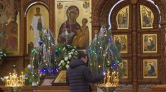 Man Puts a Candle Dormition Cathedral Christmas Worshiper Crossing Himself in - stock footage