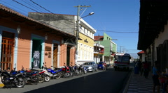 Street scene with colourful houses and traffic in Granada Stock Footage