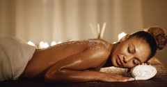 Woman Lying On Massage Table With Salt Scrub Stock Footage