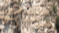 Person (woman) during bungy jump Stock Footage