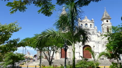 Guadalupe Church behind a small park in Granada Stock Footage