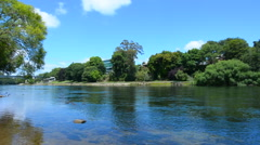 Waikato River passing through Hamilton, New Zealand Stock Footage