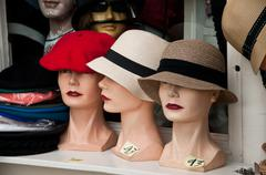 mannequin with hat in a showroom - stock photo