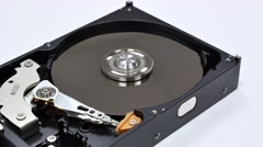 Disassembled hard drive to work. The rotation of the head of the hard disk Stock Footage