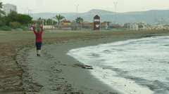 Overweight woman in sportswear jogging along sea beach to lose weight. Obesity Stock Footage