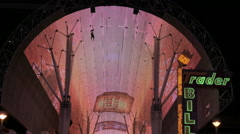 Close up of Fremont Street Experience zip lines at night Stock Footage