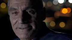 Close up of an older man, city lights Stock Footage