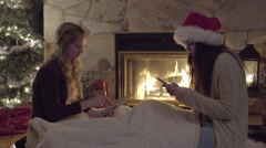 Teens Pose/Make Funny Faces For Christmas Selfies By Fire And Christmas Tree Stock Footage
