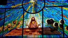 Stained glass window depicting Jesus and the twelve Stock Photos