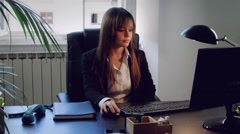 Young business woman working with computer in office Stock Footage