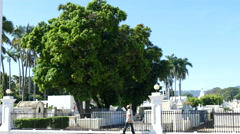 man walking in front of Nicaragua's oldest cemetery in Granada - stock footage