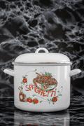 Big White Vintage Enamel Saucepan with Pumpkin Design Stock Photos