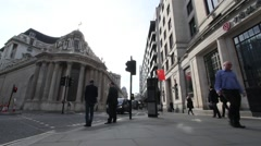 Wide angle exterior static shot of a busy Bank of England and Bank of China - stock footage