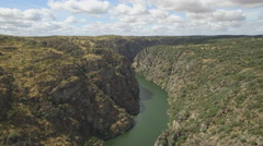 Aerial view approaching the edge of a cliff Stock Footage