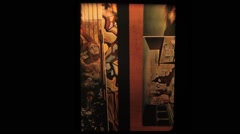 Old 8mm film strip as illustration for art history lesson slip from projector - stock footage