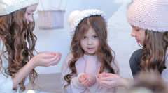 Three young beautiful girls in winter hat Stock Footage