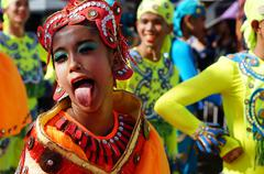 Stock Photo of Sticking out Tongue Street Cultural Dancers