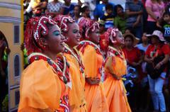 Orange Costume Street Cultural Dancers - stock photo
