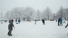 Children skate in the Park at the weekend Stock Footage