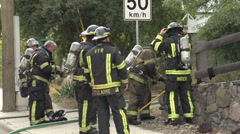 Fire scene, firefighter group at fire scene, exhausted Stock Footage