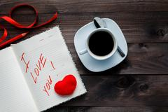 notepad and pencil with love on table - stock photo